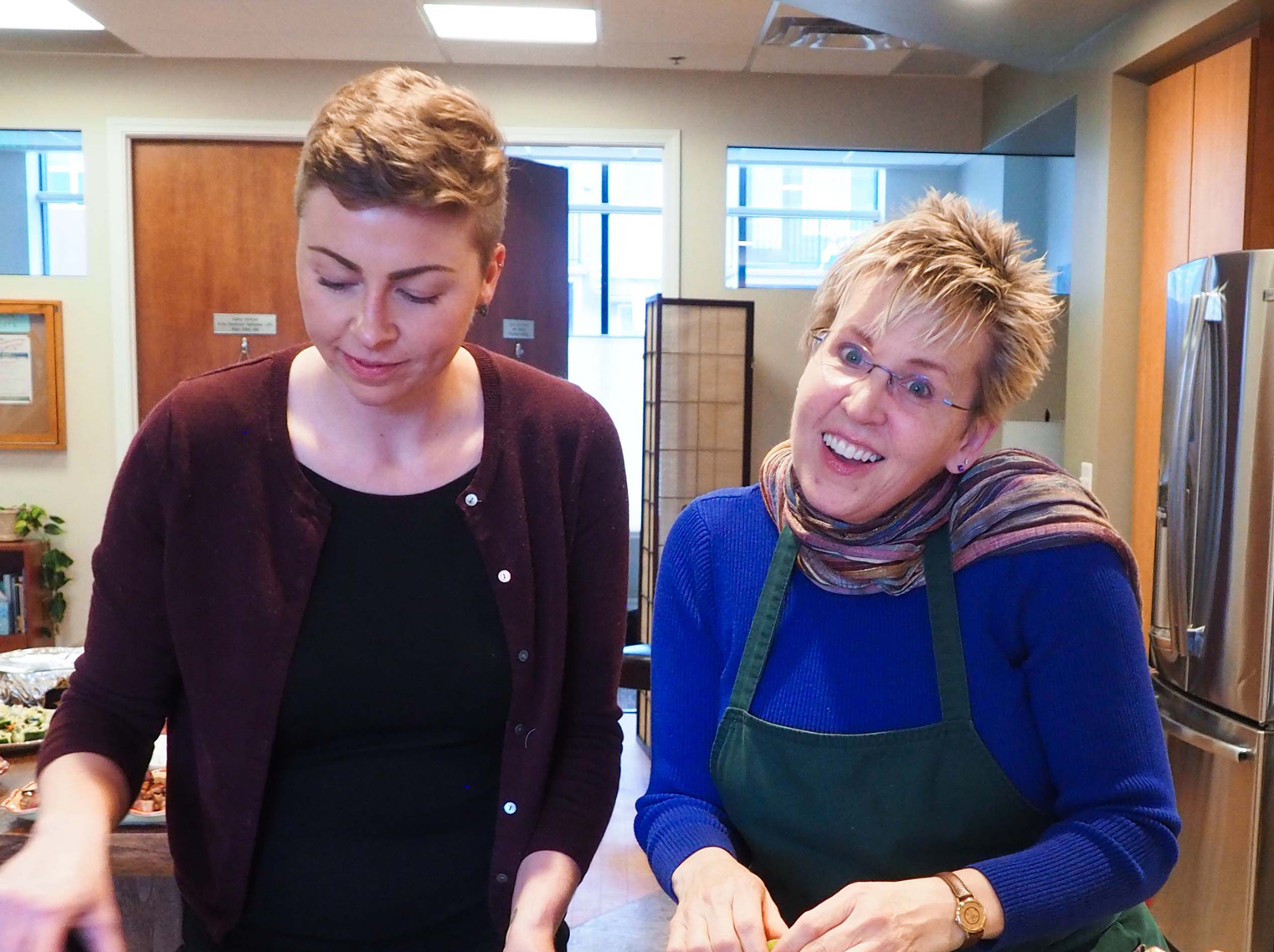 Suzanne Pearson a Lori H. cooking at WCS